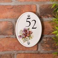 Oval ceramic number with pansy design