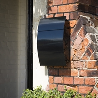 Black Tweed mailbox with curved contemporary design and hidden lock