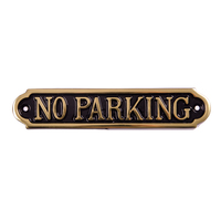 No Parking Sign in brass